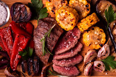 Grilled steak and vegetables on cutting board. stock photos