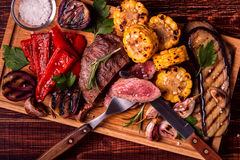 Grilled steak and vegetables on cutting board. stock photo