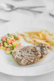 Grilled steak, vegetables and french fried. On white plate Royalty Free Stock Photography