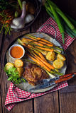 Grilled steak with vegetables and fried potatoes Stock Image
