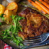 Grilled steak with vegetables and fried potatoes Stock Photo