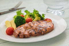 Grilled steak and vegetables on plate Stock Image