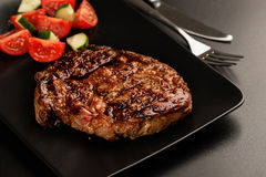 Grilled steak and vegetables on plate Royalty Free Stock Photography