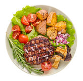 Grilled steak with vegetables and rosemary above. Grilled steak with vegetables and rosemary top view on white stock photos