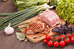 Grilled steak with vegetables. On a wooden board Stock Photo