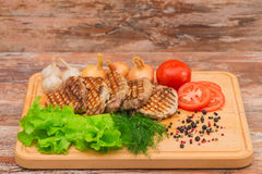 Grilled steak with vegetables on a wooden board Royalty Free Stock Photography