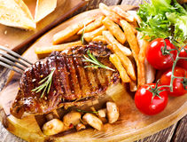 Grilled steak with vegetables Stock Photos