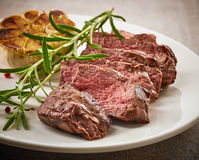 Grilled steak on white plate Royalty Free Stock Photos