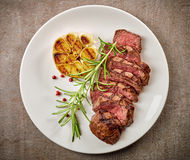 Grilled steak on white plate Stock Image