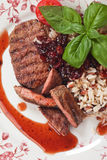 Grilled steak wit rice and cranberry sauce Stock Image