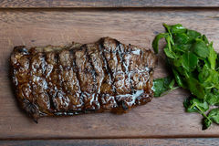 Grilled Steak on Wooden Board Stock Photos