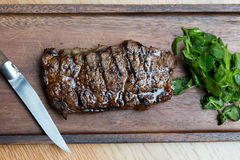 Grilled Steak on Wooden Board Royalty Free Stock Images