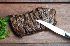 Grilled Steak on Wooden Board Royalty Free Stock Photo