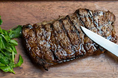 Grilled Steak on Wooden Board Stock Image