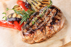 Grilled steak with zucchini and peppers Stock Photos