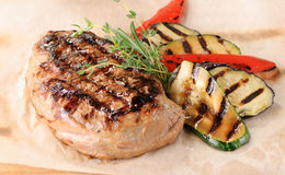 Grilled steak with zucchini and peppers Stock Photography