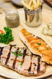 Grilled steaks Chicken and Salmon. Grilled steaks Chicken and Salmon, baked potatoes and vegetables Stock Photo