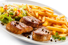 Grilled steaks and French fries Stock Image
