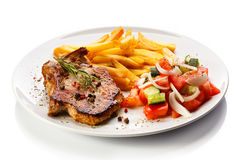 Grilled steaks and French fries Royalty Free Stock Photography