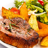 Grilled steaks and vegetables Royalty Free Stock Image