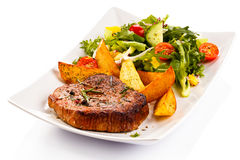 Grilled steaks and vegetables Royalty Free Stock Images
