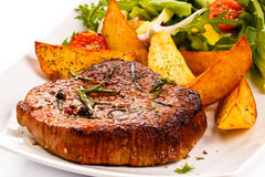 Grilled steaks and vegetables Stock Photo