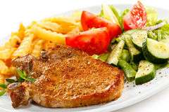 Grilled steaks and French fries Royalty Free Stock Image