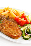 Grilled steaks and French fries Stock Photo
