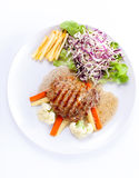 Grilled steaks, French fries and vegetables Royalty Free Stock Photography