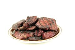 Grilled Steaks isolated. On a serving plate royalty free stock photos