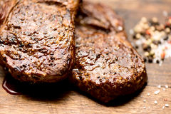 Grilled steaks juicy macro Royalty Free Stock Images