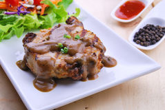 Grilled steaks, pork with pepper gravy and vegetable salad Stock Images