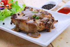 Grilled steaks, pork with pepper gravy and vegetable salad Stock Photo