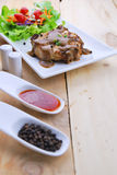 Grilled steaks, pork with pepper gravy and vegetable salad Royalty Free Stock Images