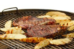 Grilled steaks and potatoes Stock Photos