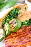 Grilled steaks with puff pastry bag and zucchini Royalty Free Stock Image