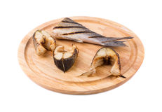 Grilled steaks and tail of seabass. Royalty Free Stock Photo