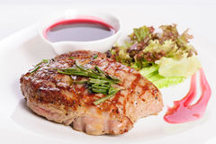 Grilled steaks and vegetable salad Stock Photography