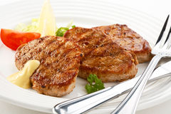 Grilled steaks with vegetables Royalty Free Stock Photos