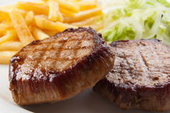 Grilled steaks with vegetables Stock Image