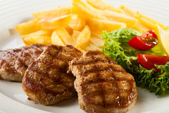 Grilled steaks with vegetables stock photo