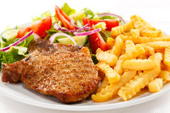 Grilled steaks with vegetables Royalty Free Stock Photography