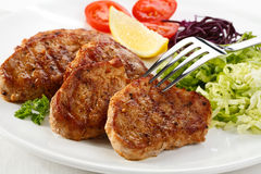 Grilled steaks with vegetables Royalty Free Stock Image