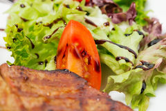 Grilled steaks with vegetables. Stock Photos