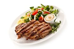 Grilled steaks and vegetables stock photos