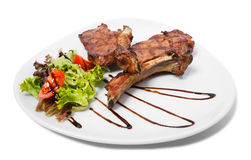 Grilled steaks with vegetables. Royalty Free Stock Photos