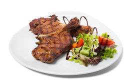 Grilled steaks with vegetables. Stock Image