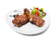 Grilled steaks with vegetables. Royalty Free Stock Photo