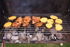 Grilled steaks and vegetables like sweet potatoes and zucchini cooked on the garden grill. Stock Images