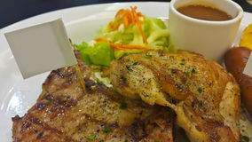 Grilled steaks and vegetables. Grilled steaks and vegetable salad steak, chicken salad Royalty Free Stock Photography